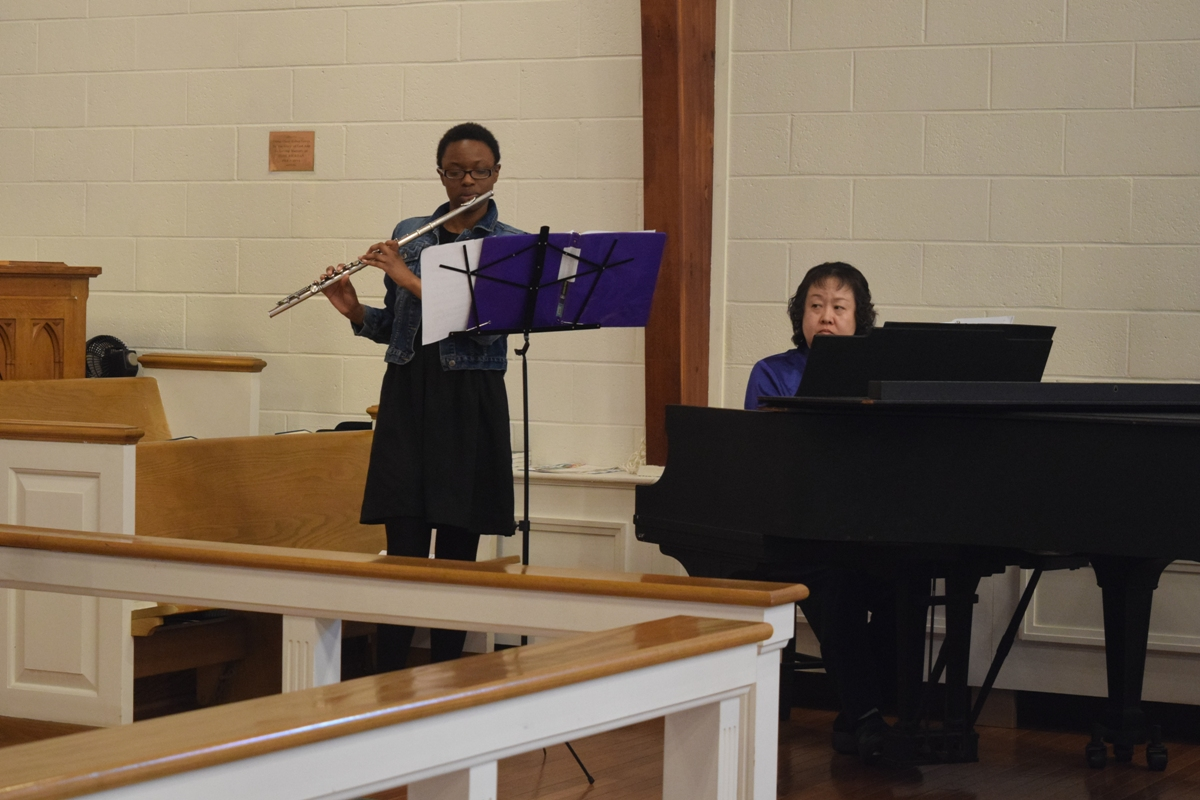 Our Music Director on Piano and Sunday School Teacher on Flute